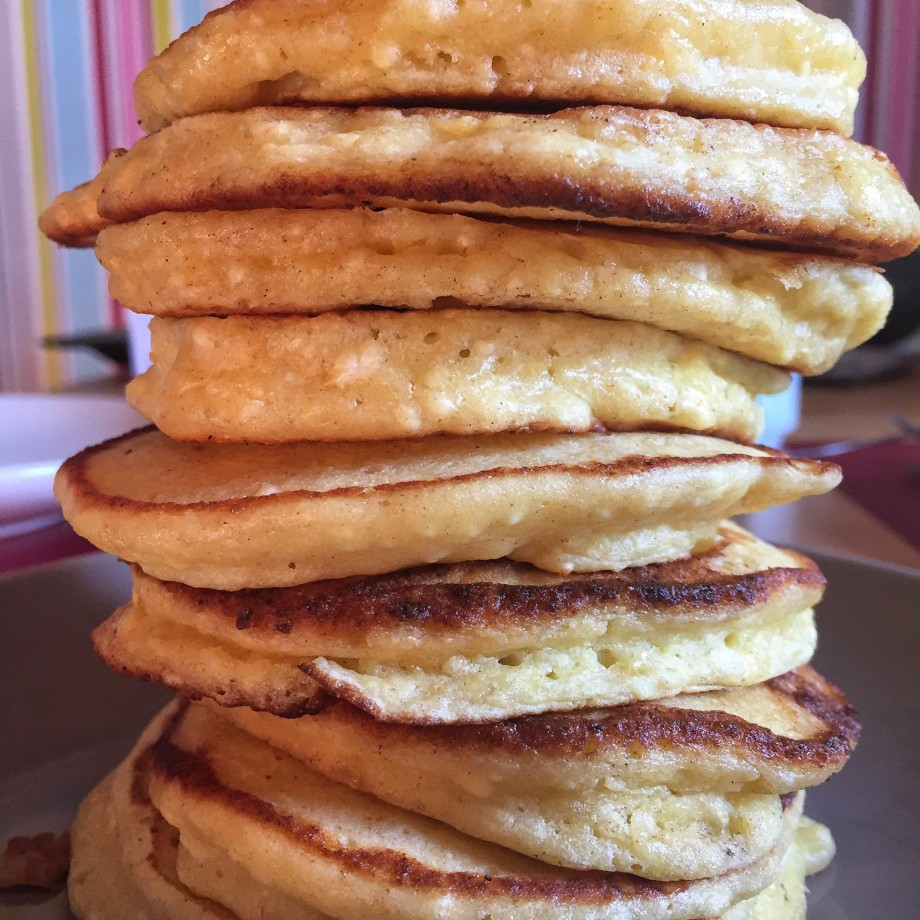A fluffy stack of ricotta pancakes.